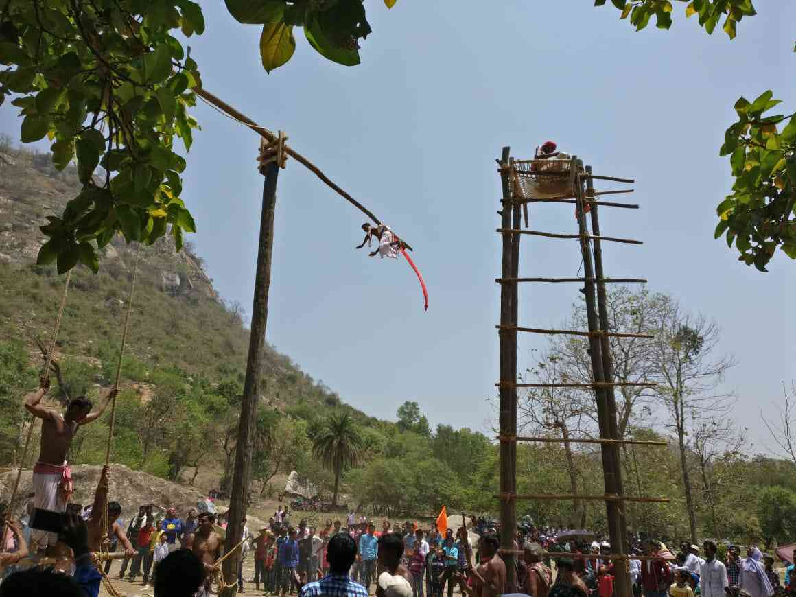 The Gajan festival is celebrated with sanyasis swinging from poles suspended from iron hooks in their back. Credit: Shoaib Daniyal