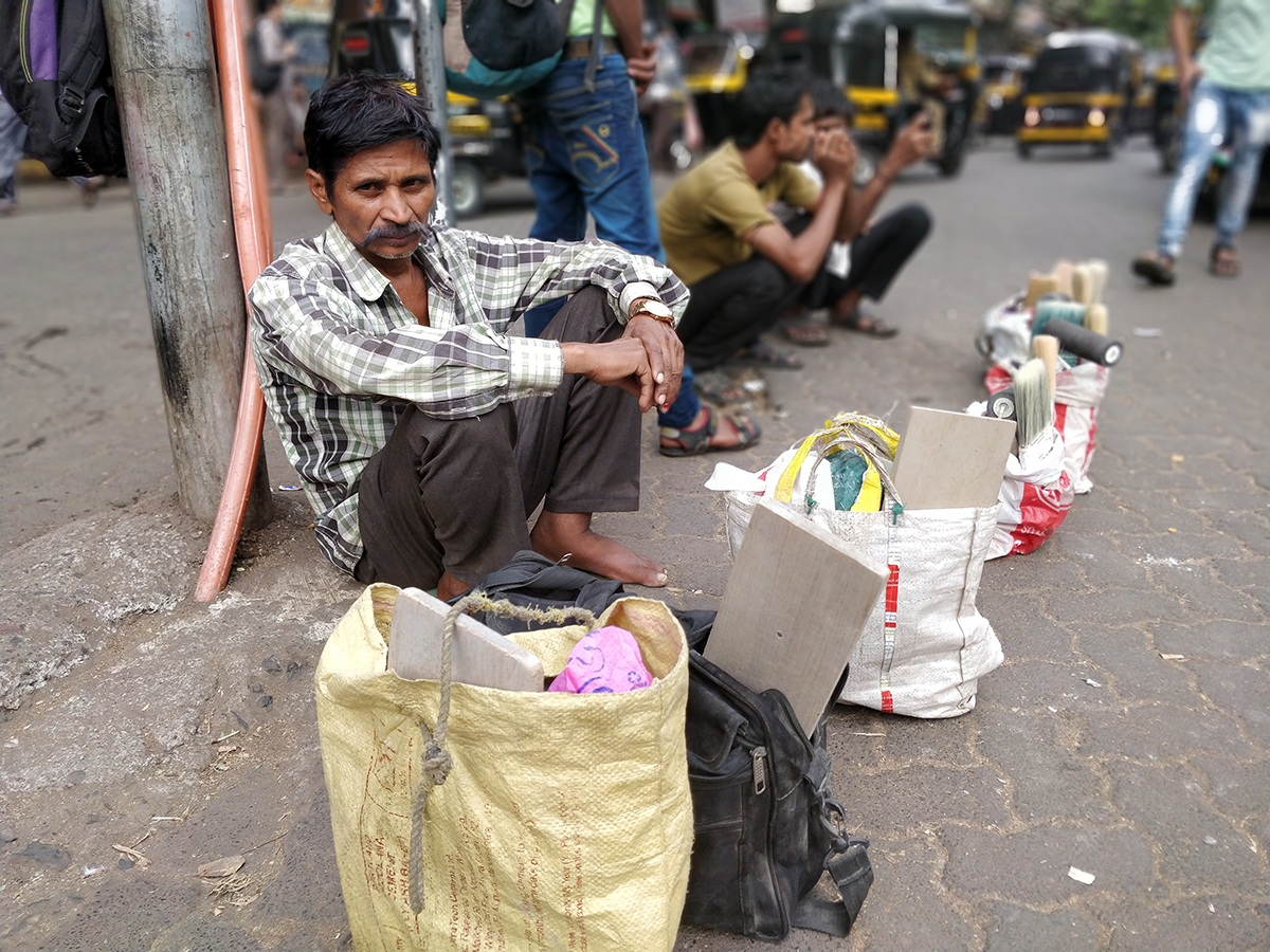 A painter waiting for work at the labour naka outside the Khar railway station in Mumbai. Photo: Shone Satheesh