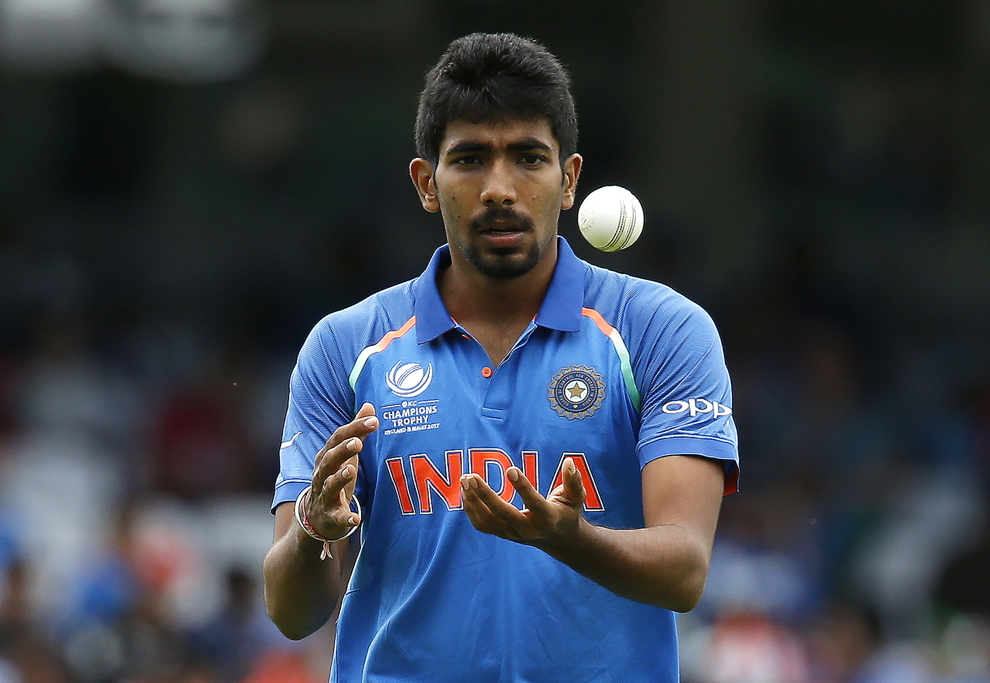 Jasprit Bumrah gets his maiden wicket off the ICC Champions Trophy. Photo: AFP.