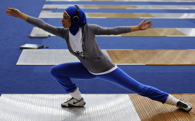 Egypt's Eman Gaber, wearing a sports hijab during a practice session before the start of the London 2012 Olympic Games. (Credit: Kim Kyung Hoon / Reuters)