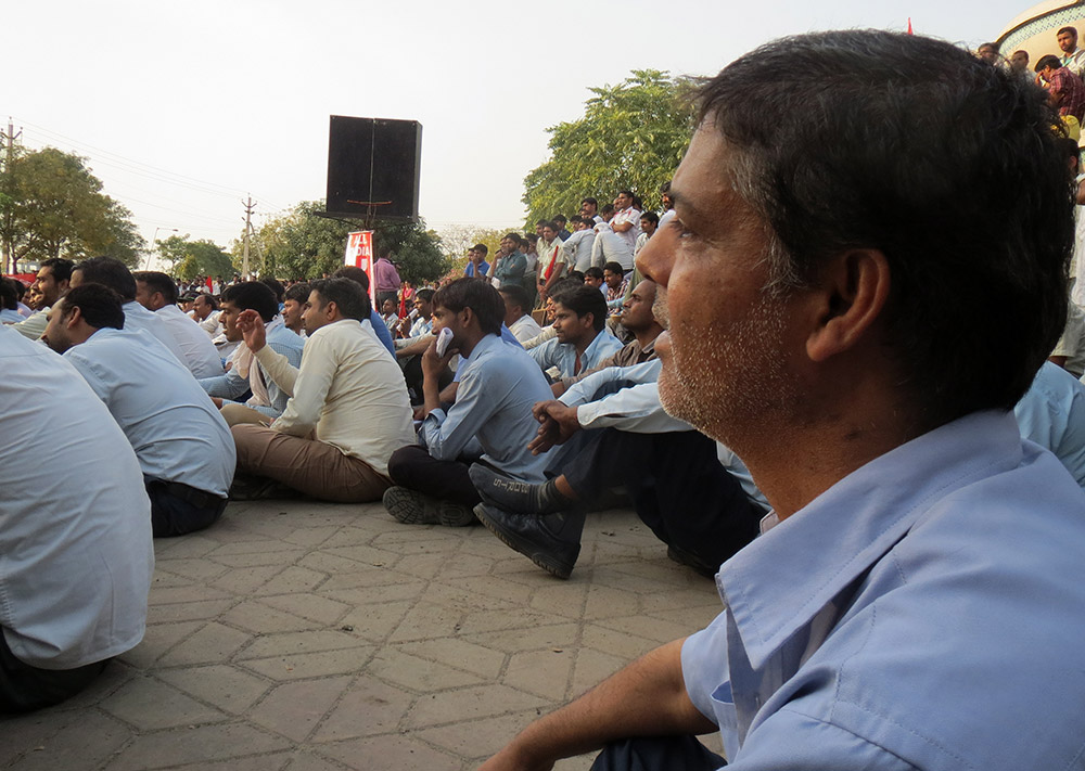 A permanent worker with STI Sanoh India Private Limited Manesar, a vendor company for Maruti Suzuki, joins the public meeting after working the morning shift.
