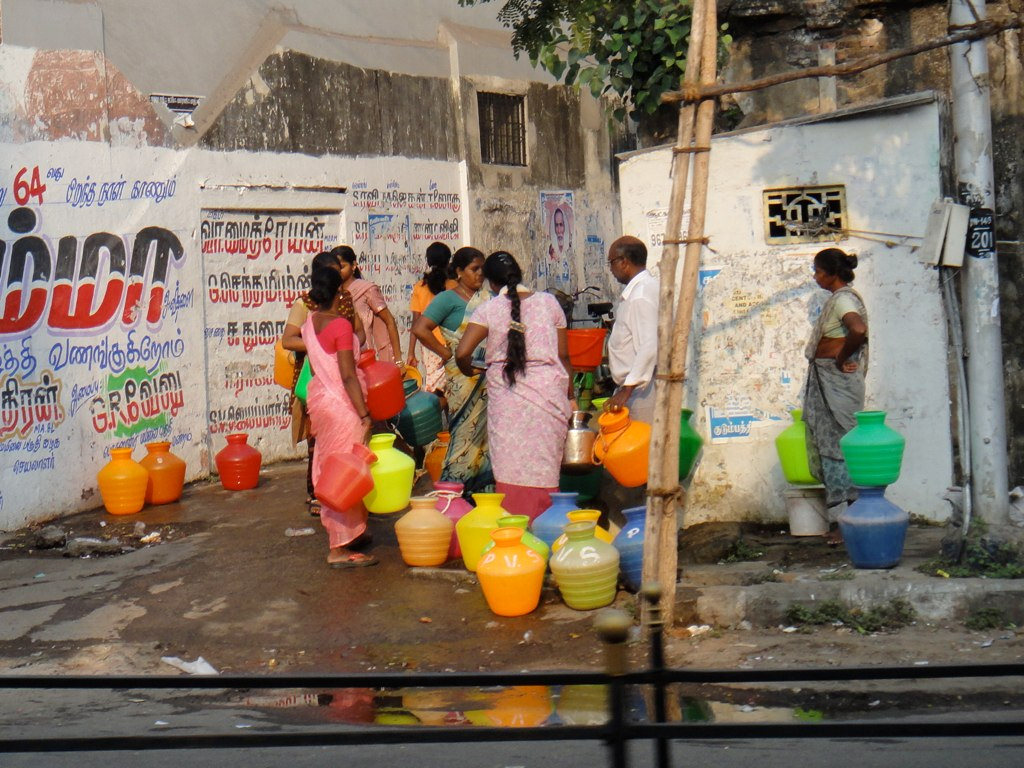 Before rainwater capture strategies were implemented in Chennai, many families needed to haul water in plastic pots to supplement that available from backyard wells.. Photo credit: Rajesh_India/via Flickr [Licensed under CC BY 2.0]