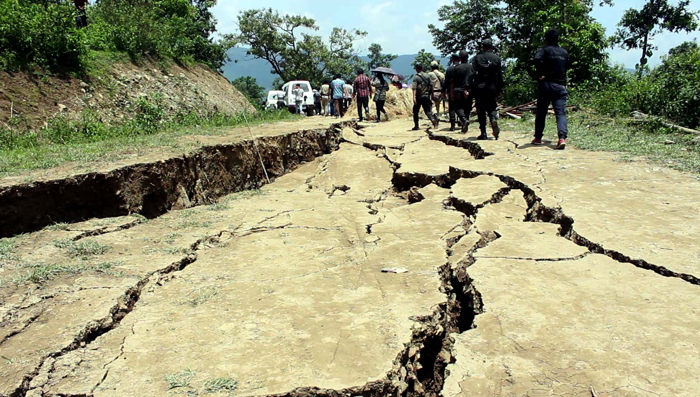 Earth cracks spread to the recently constructed Pradhan Mantri Gram Sadak Yojana Road.