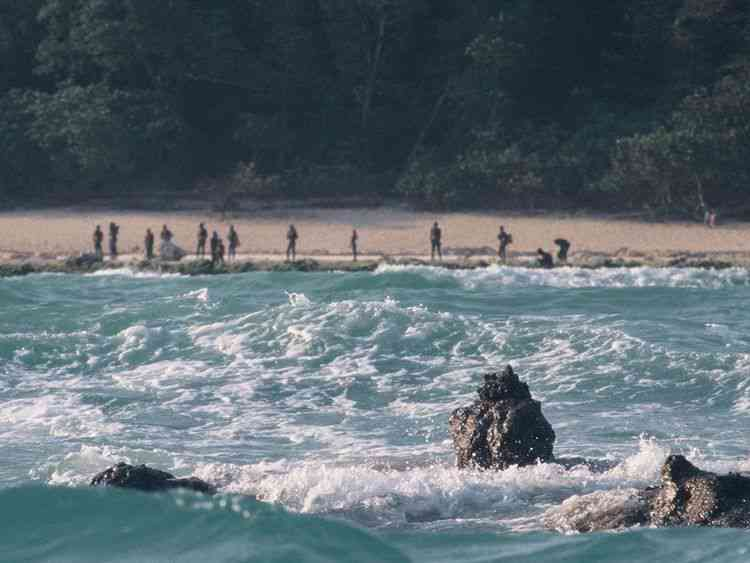 The Sentinelese people stand guard on the shore of their North Sentinel Island. Photo credit: Creative Commons