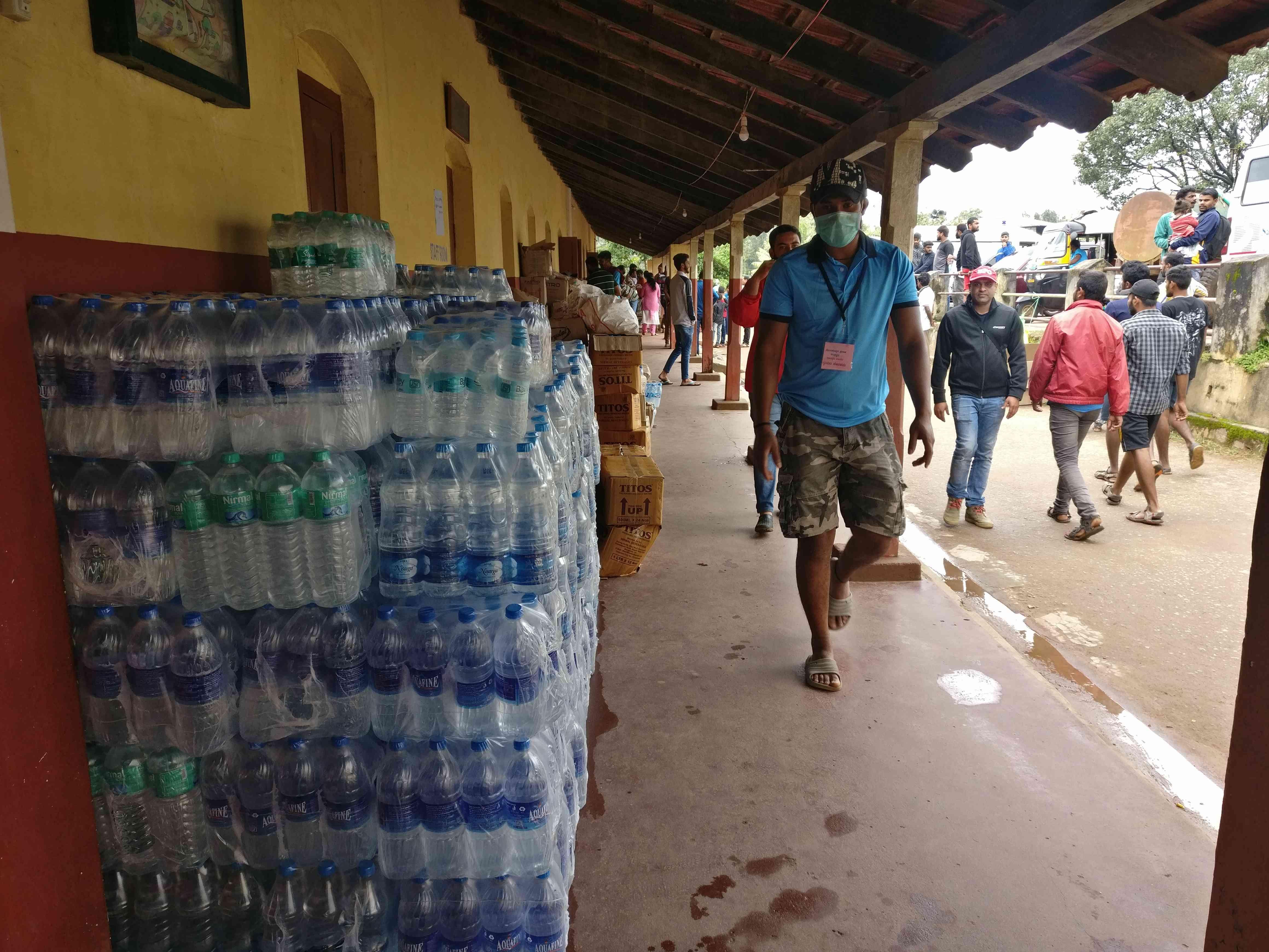 Relief material piles up at a shelter in Suntikoppa town in Kodagu. (Credit: Nayantara Narayanan)