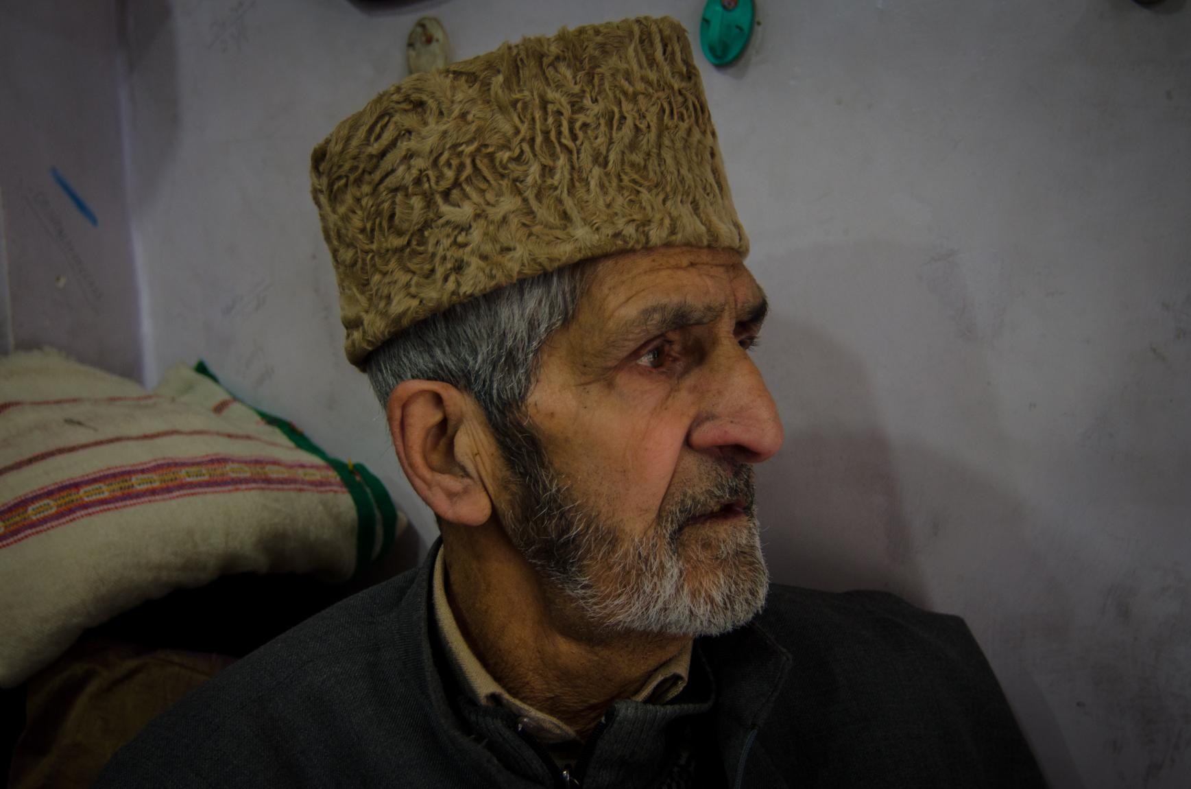 Photo  Rayan Naqash Maqbool Shah wearing a Karakuli cap. Photo  Rayan Naqash 356c928859f