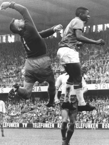 Pelé fights for the ball against the Swedish goalkeeper Kalle Svensson during the 1958 World Cup final. Photo credit: Scanpix/Wikimedia Commons