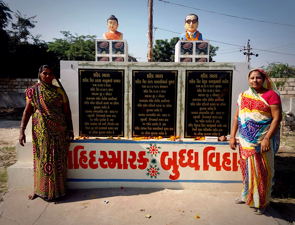 Mothers of two of the three deceased Dalit youth at a memorial built for them in Thangadh. Photos credit: Aarefa Johari.
