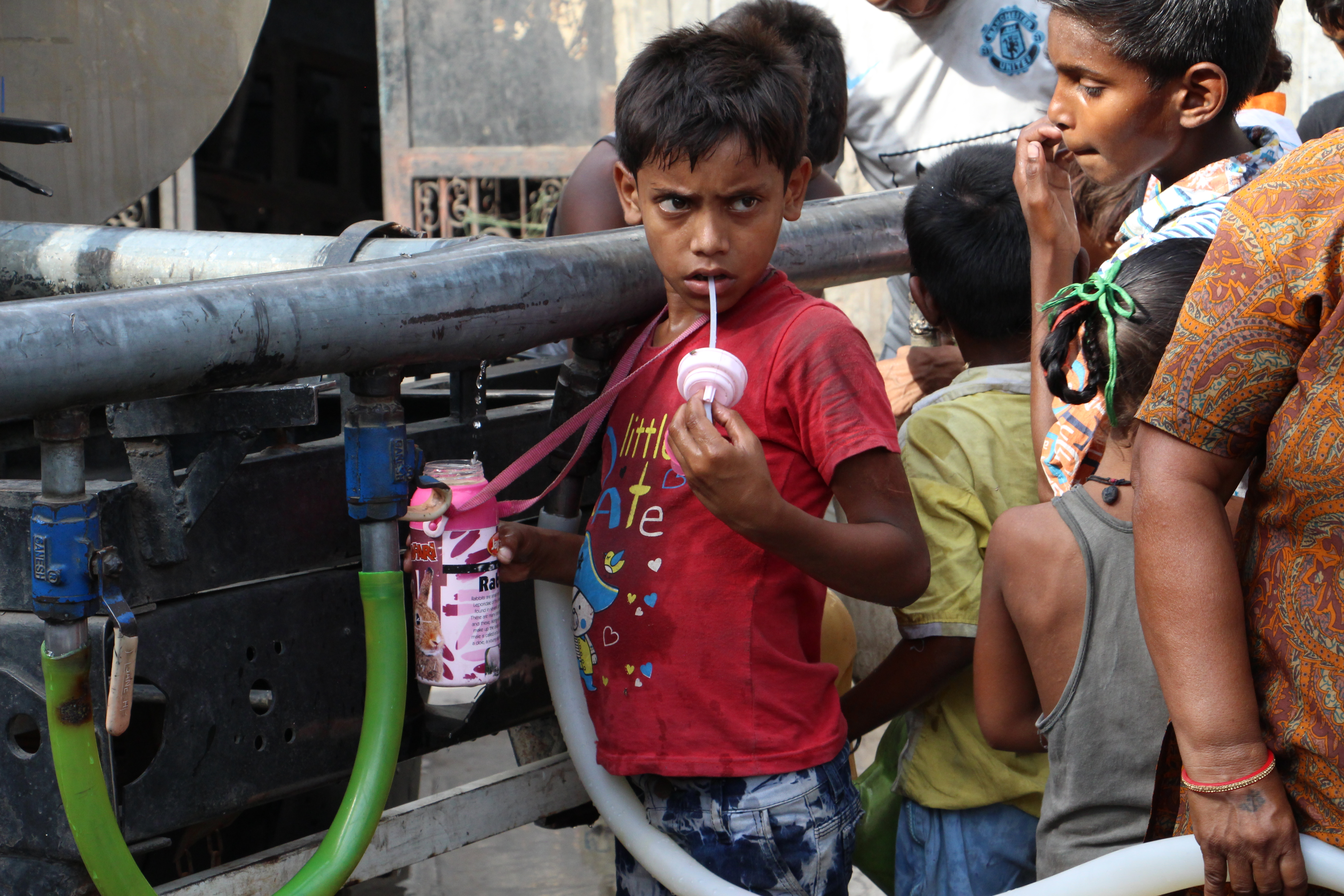 Children take water from a tanker in Wazirpur. Photo credit: Aabid Shafi