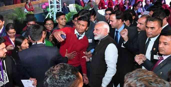 Prime Minister Narendra Modi takes photos with students at his Pariksha Pe Charcha event. Credit: narendramodi.in