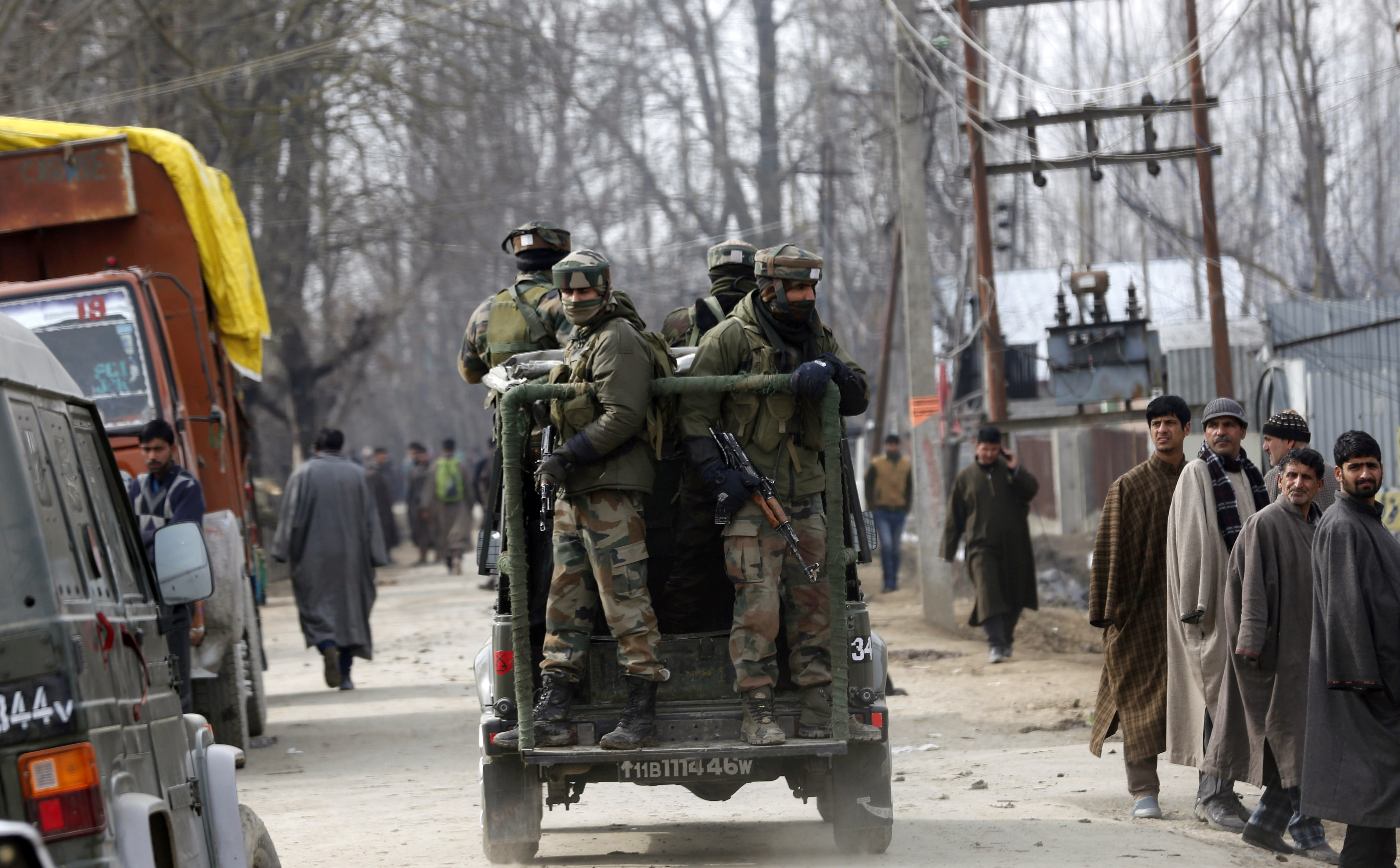 Security personnel in Hajin after a gunbattle with suspected militants in February. (Credit: AFP)
