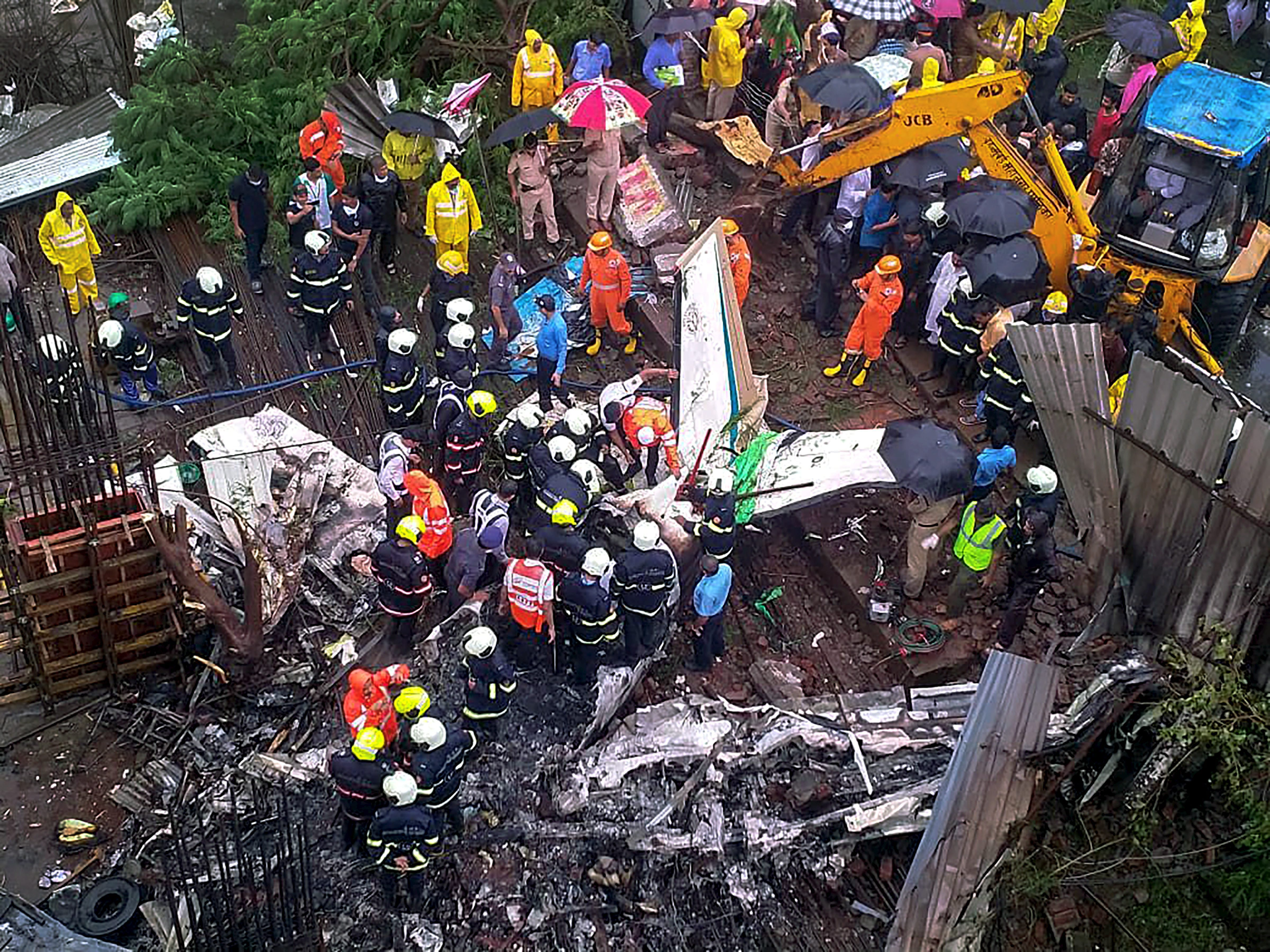 Rescue personnel at the crash site. (Credit: PTI)
