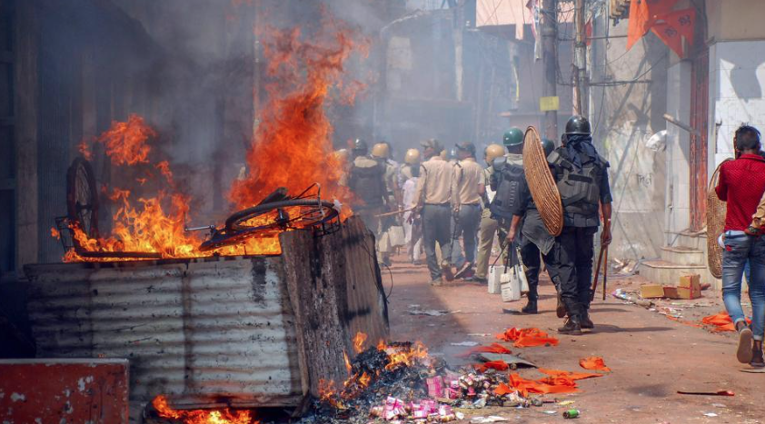 Police patrol the streets of Raniganj, Asansol, after a Ram Navami procession turned violent. (Credit: PTI)