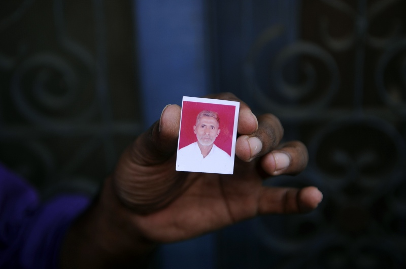 A relative holds a photograph of Mohammad Akhlaq in the village of Bisada near Delhi. Akhlaq was lynched by a mob in September 2015 after rumours that he had eaten beef. (Photo credit: AFP).