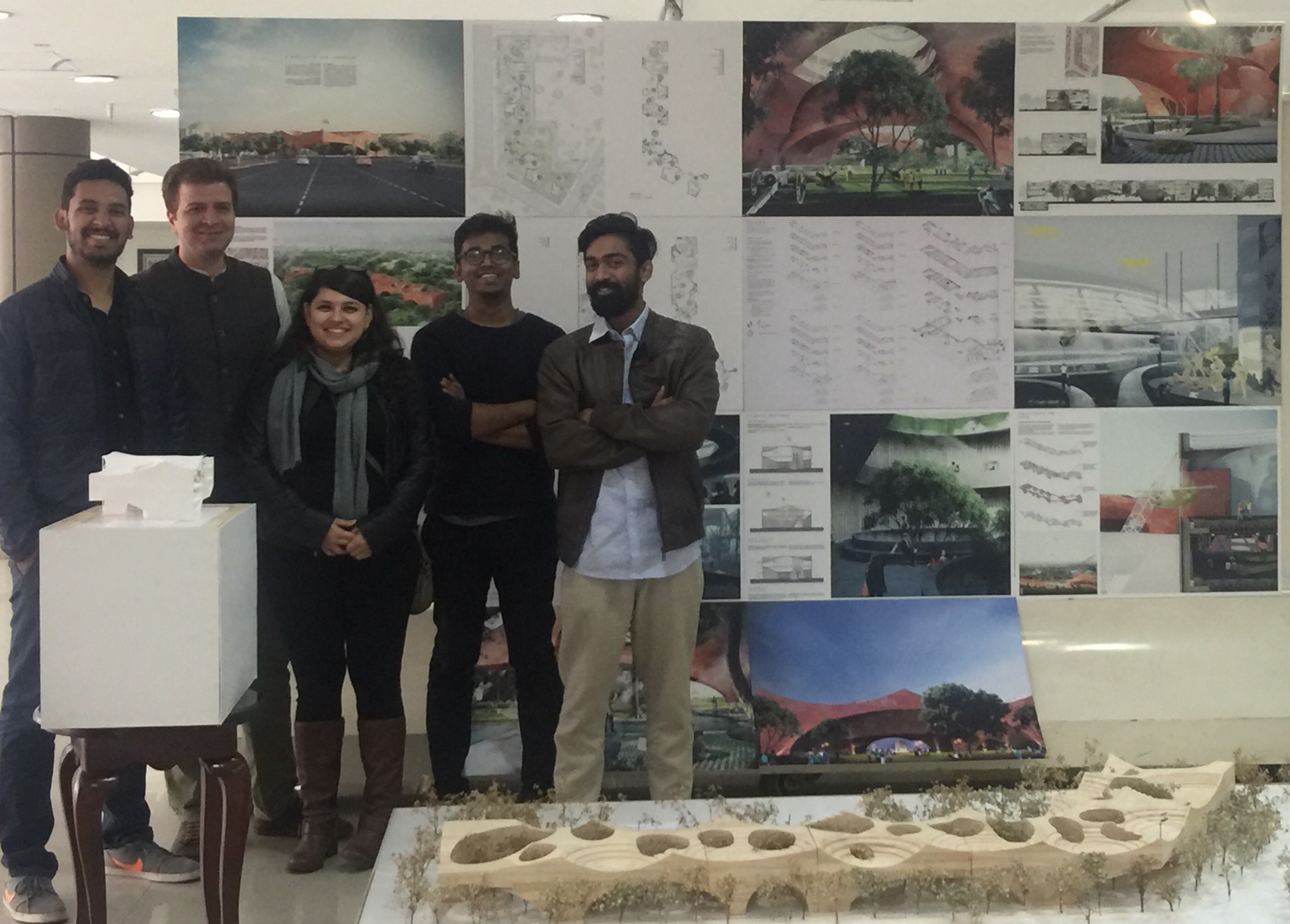 Sameep Padora and his team with the model of their design. Photo courtesy Studio sP+a