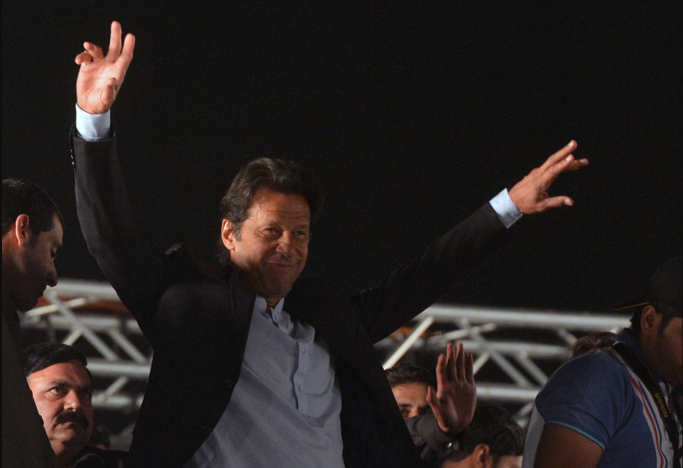 """""""As far as the federal government goes, whether by hook or by crook, they [the Army] will get a coalition government led by [Imran Khan's] Tehreek-e-Insaf."""" (Credit: Asif Hassan/AFP)"""
