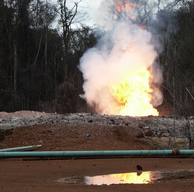 Gas flare from an oil field in the Congo Basin rainforest. William Laurance
