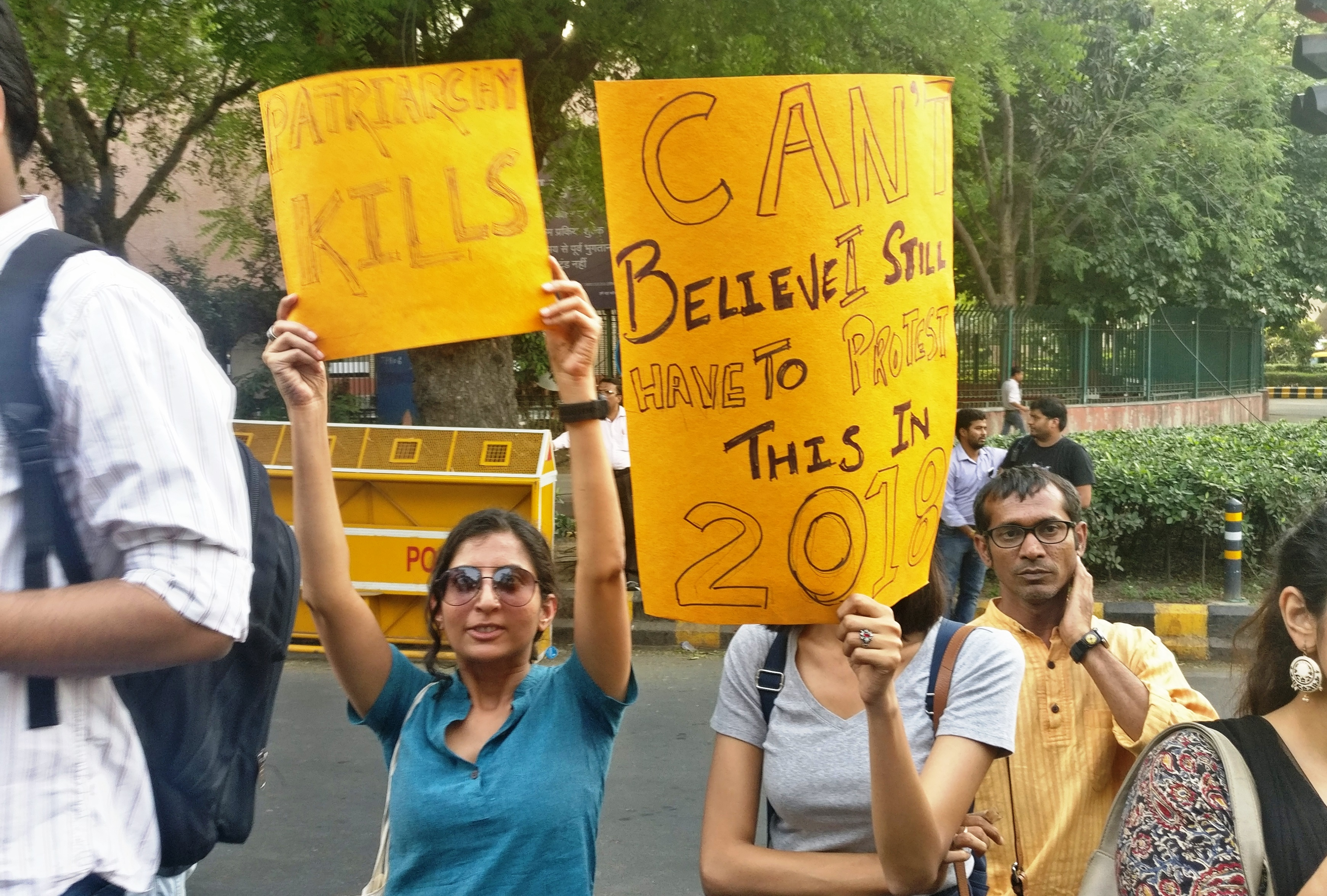 Women hold placards at the New Delhi protest on Sunday evening. (Rohan Venkataramakrishnan/Scroll.in)