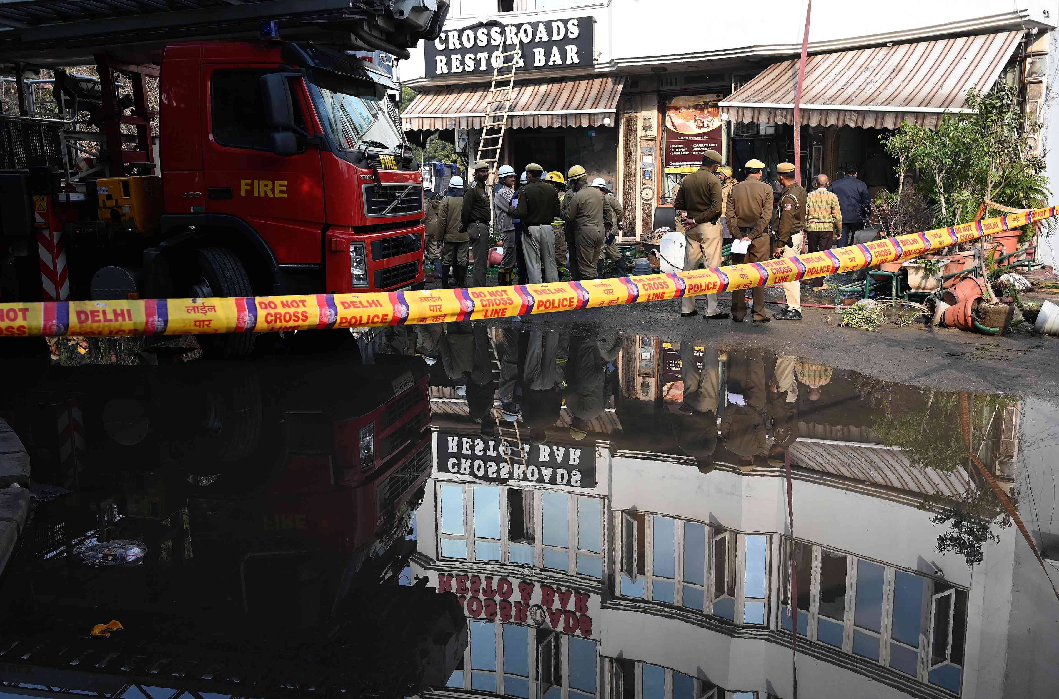 Rescue and police personnel at the site of a massive blaze at Hotel Arpit Palace on Tuesday, after the fire had been doused. (Photo credit: AFP)