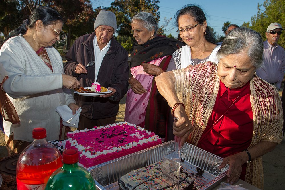 Fremont, California: Seniors gather in a park to celebrate the birthday of one of their group who turned 94. Many live in India and spend summers with their children in California while their grandchildren's schools are out of session. They return after school starts in the fall and the heat in India has passed.