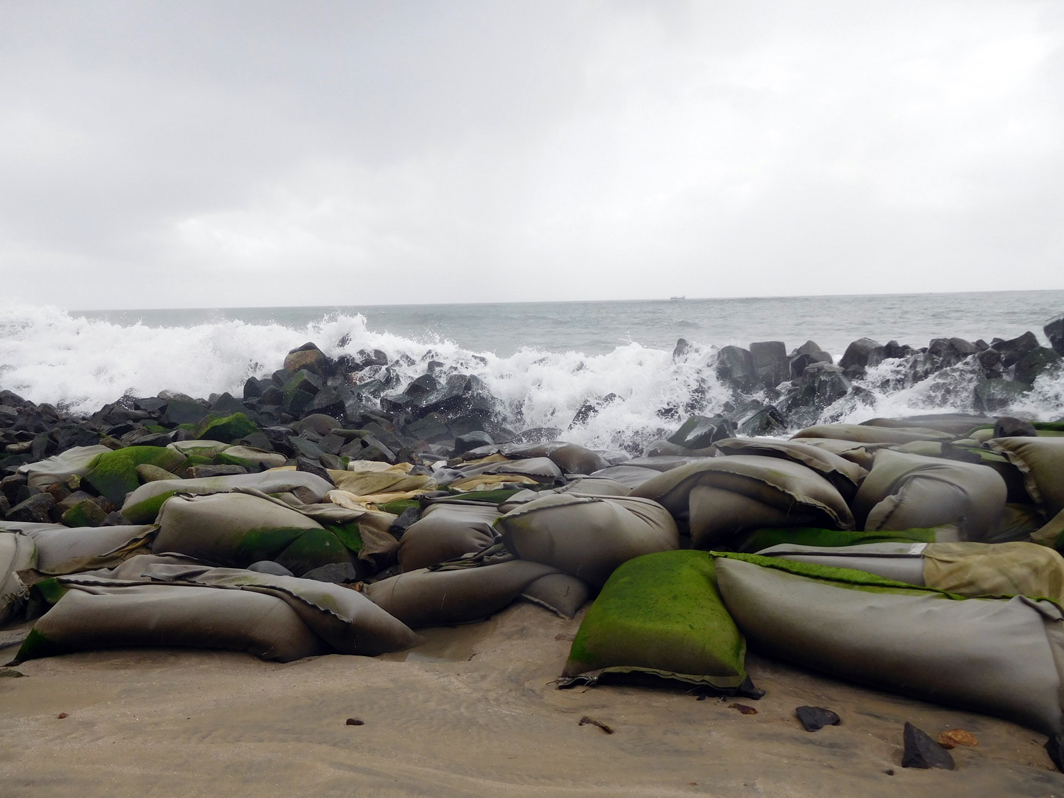Huge waves destroyed the sea wall in Companyppadi neighbourhood in Chellanam. In the foreground are sandbags placed by village residents to prevent erosion. (Photo credit: TA Ameerudheen).