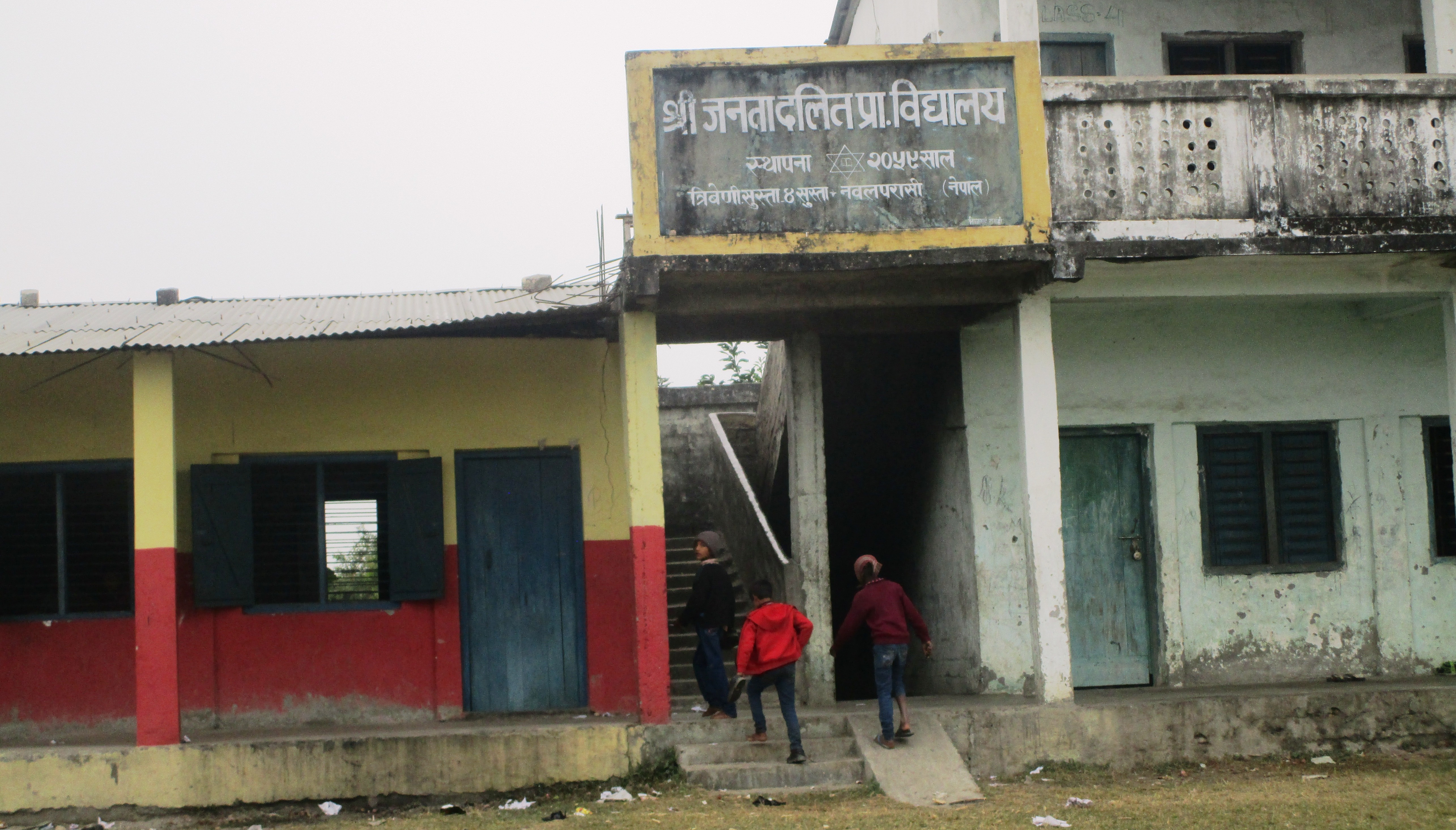 Shri Janta Dalit Primary School, the only school in Susta, whose painted wall reads Nawalparasi, Nepal.