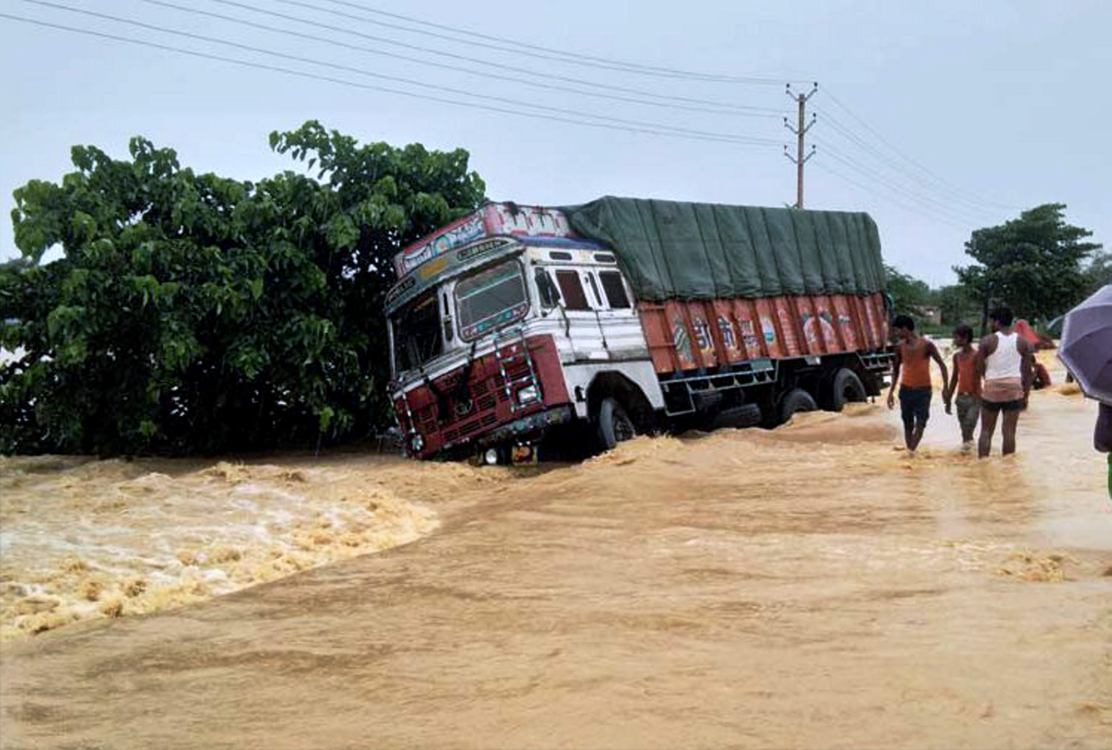 A truck drifts off the submerged NH-28 in Bihar's East Champaran district. (Credit: PTI)