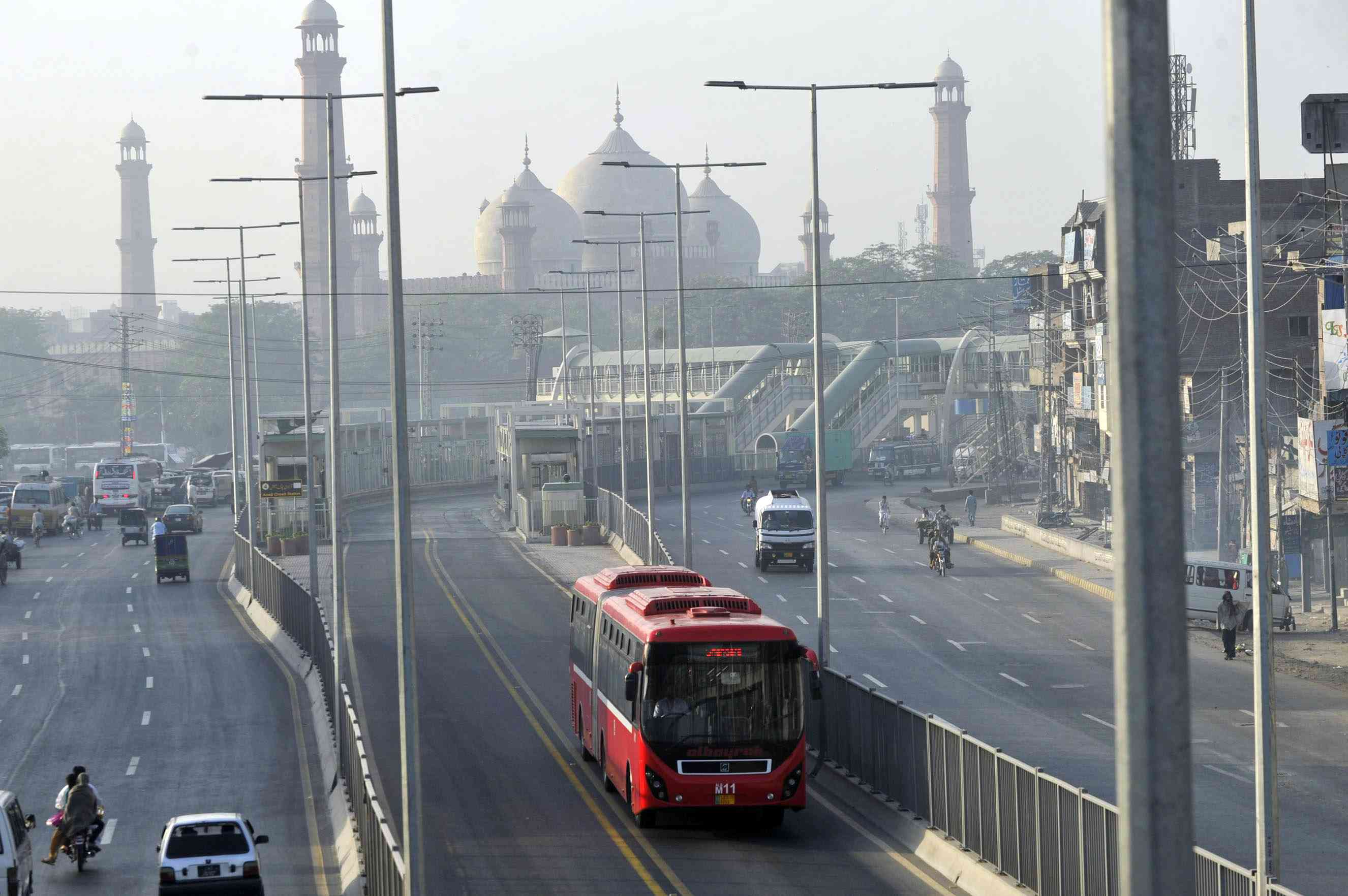 A Pakistani metro bus travels along a highway in Lahore. (Photo credit: Arif Ali/AFP)