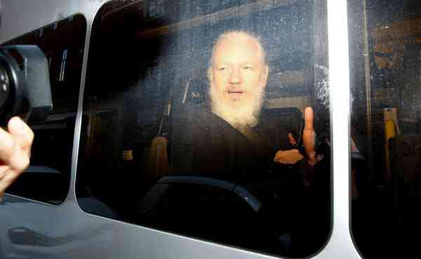 WikiLeaks founder Julian Assange in a police van, after his arrest by British police, in London, April 11, 2019. Photo Credit: Reuters/Henry Nicholls