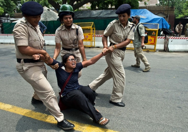 The Delhi police detains a protestor during a demonstration against Israeli attacks on Gaza outside the Israeli embassy in New Delhi on July 14, 2014. (Photo credit: AFP).
