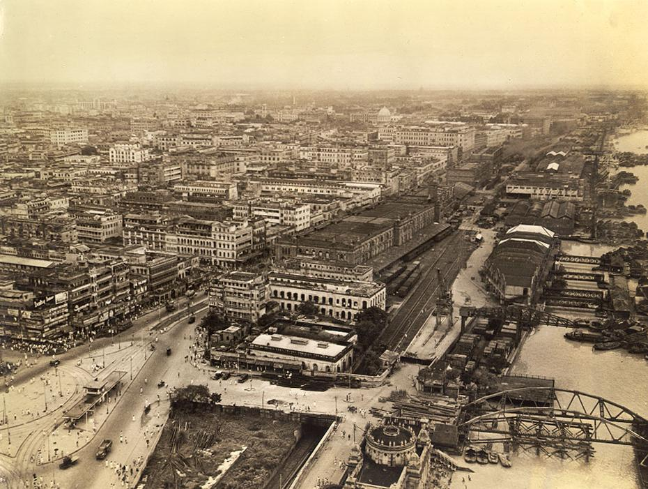 """""""Aerial view of Calcutta downtown. In upper left background is Hindusthan building, U.S. Army HQ. The oldest part of the city starts at the esplanade and extends upwards. The city was founded in the early 1700s."""" Photo credit: Clyde Waddell/University of Pennsylvania/Wikimedia Commons [Public Domain]"""
