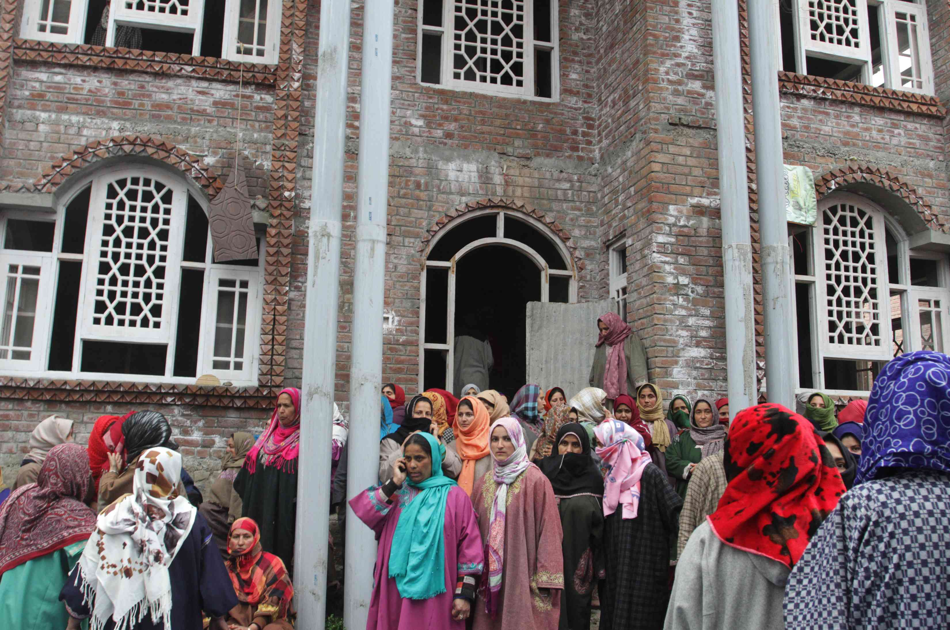 Women mourners outside the Pandit home in Awantipora on Tuesday. (Photo credit: Safwat Zargar).