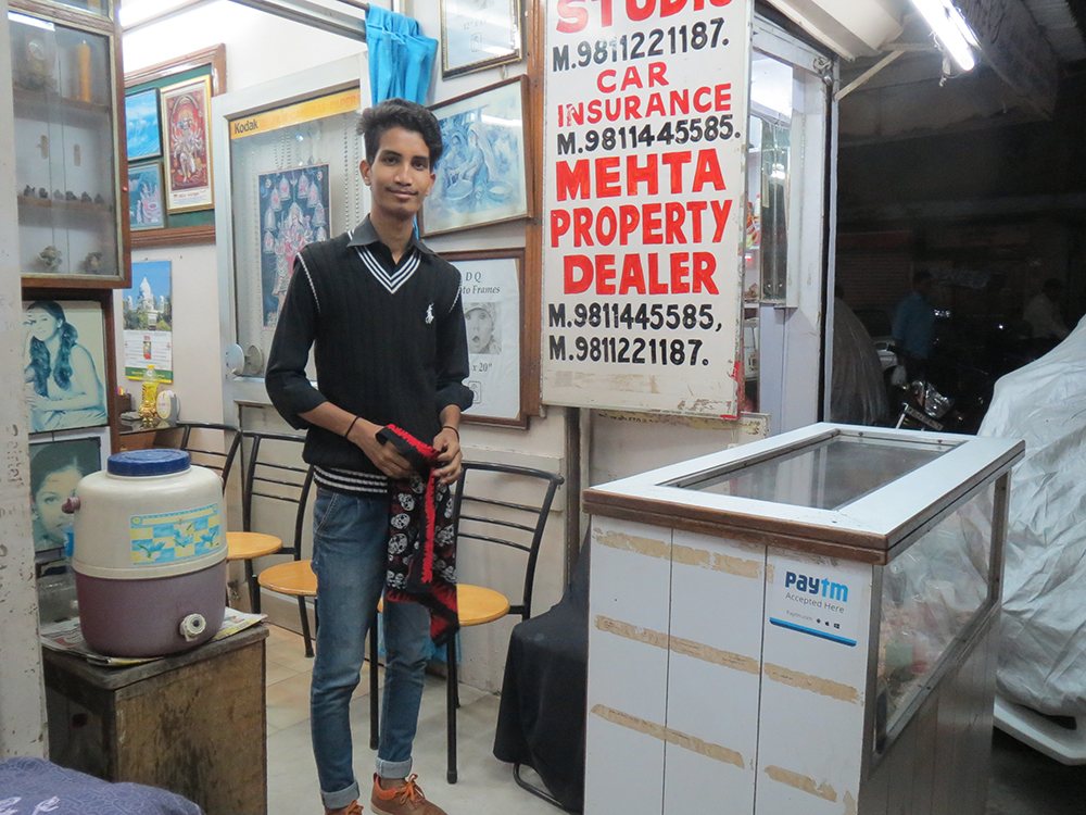 Aman Abbasi says someone stuck a PayTM sticker outside the shop where he works but he did not know how to use the app to make or receive payments.  (Photo credit: Anumeha Yadav).