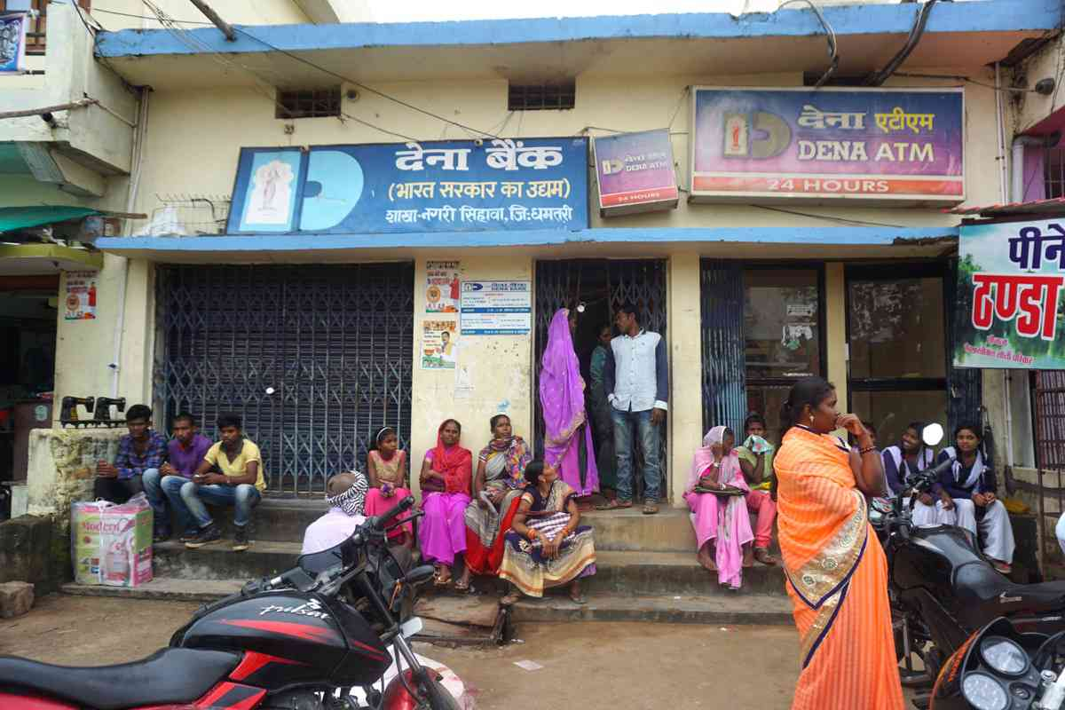 The residents of Nagari town in Dhamtari district start lining up outside the largest bank every morning well before it opens.
