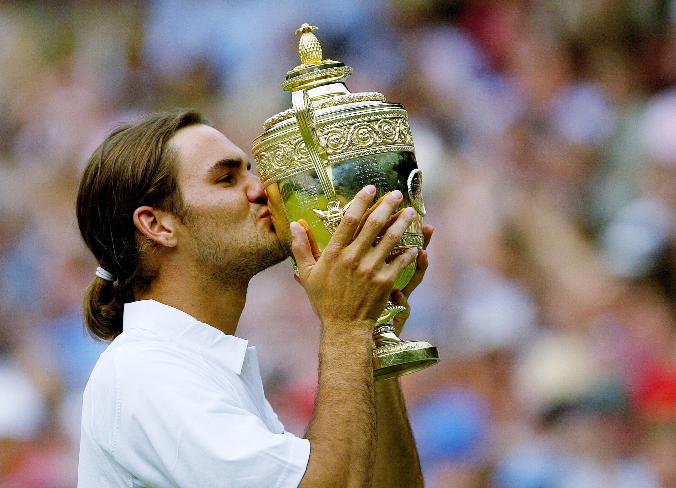Federer after his first Wimbledon title/Courtesy: Reuters