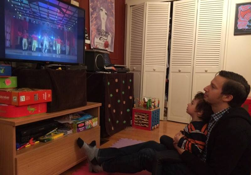 David Bertrand watches Disco Dancer with his child.