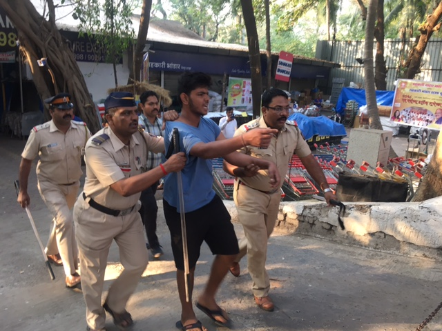 A Dalit youth being detained by the police. Photo credit: Priyanka Vora