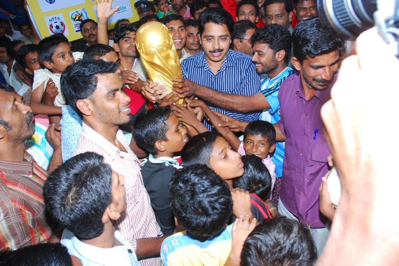 Fans of the Spain football team receive the replica of the World Cup in 2010. (Photo courtesy: Ninan Valappu Football Fans Association).