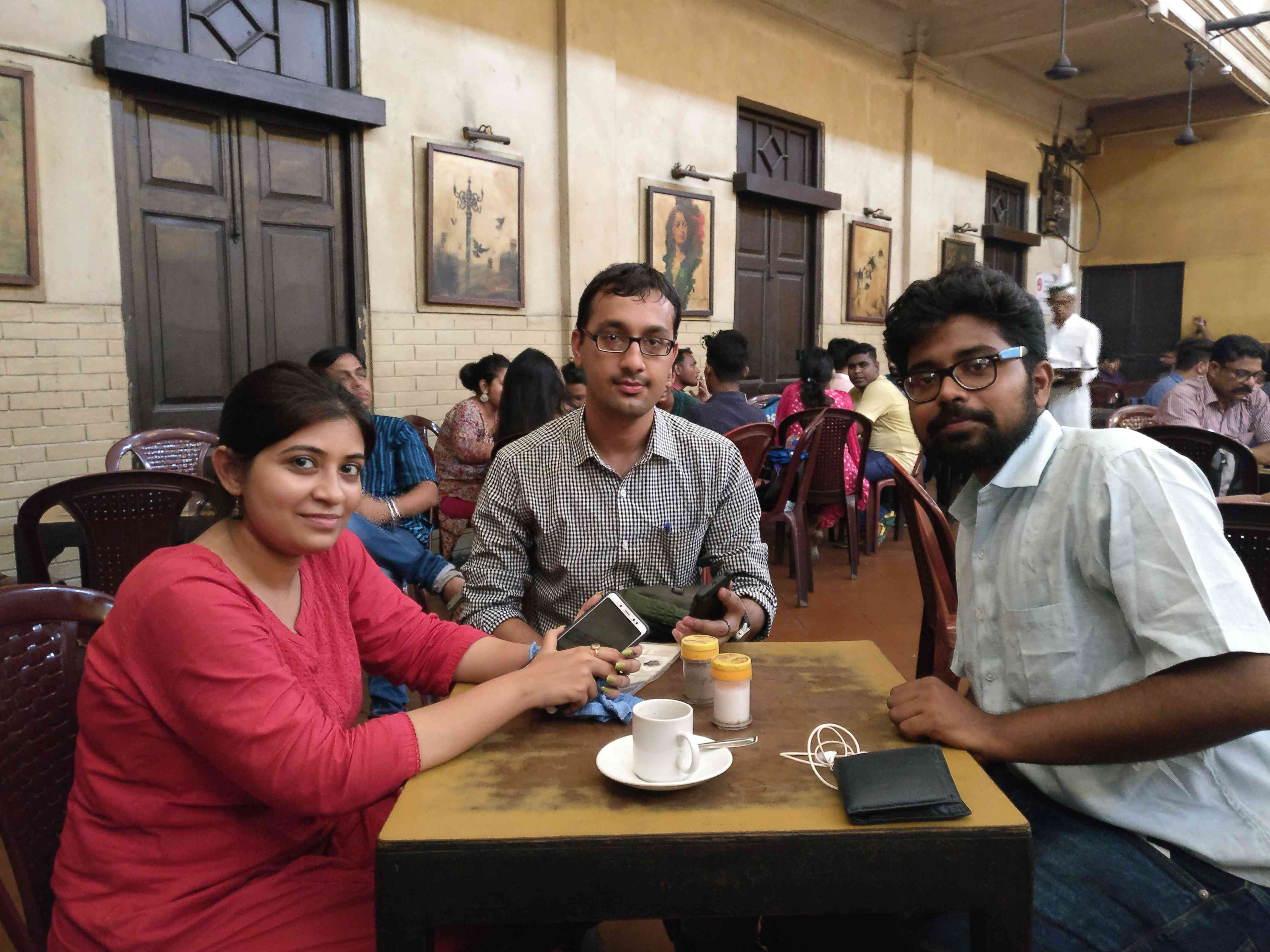 Aditya Aashish, centre, at Kolkata's iconic Coffee House. He believes 'Modi is working towards the development of the country'. Photo credit: Shoaib Daniyal