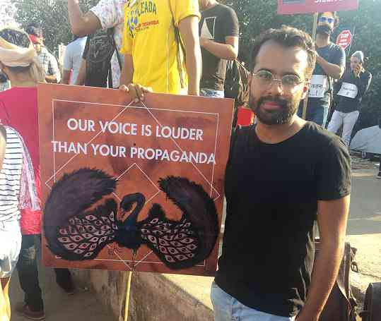 Karan Talwar with his placard at the march. Photo credit: Sruthi Ganapathy Raman