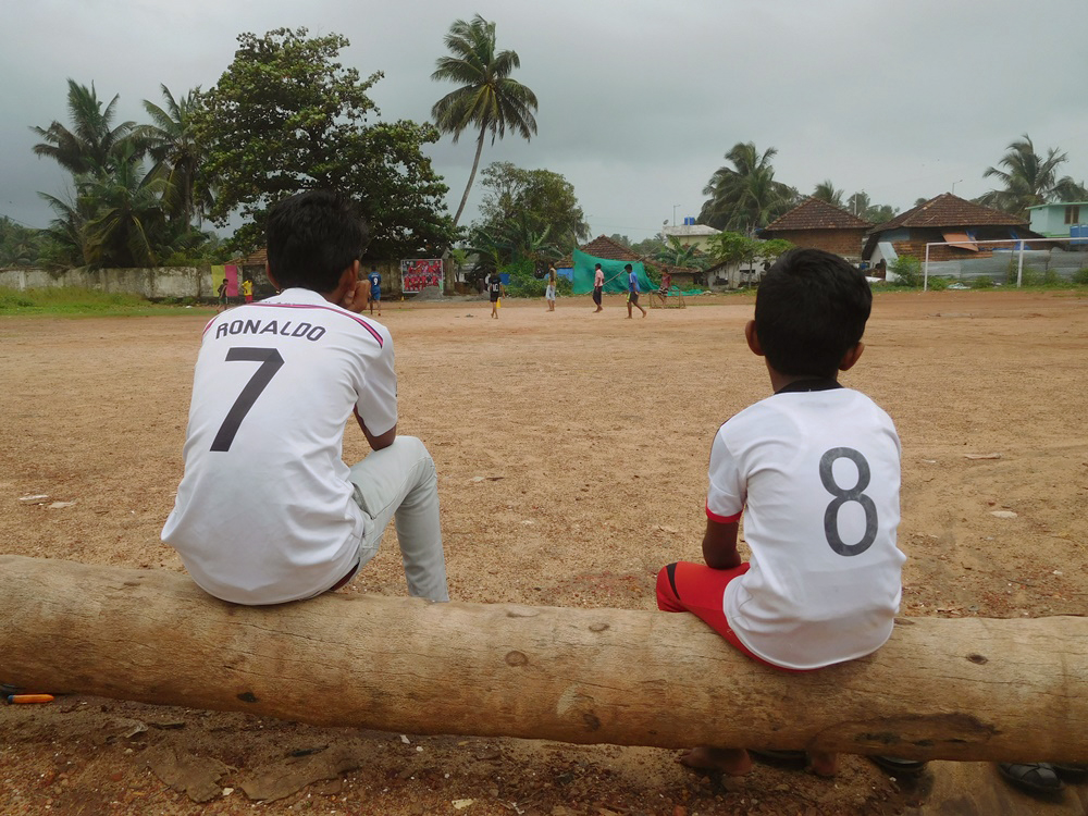 Children watch a football match in Ninan Valappu. (Photo credit: TA Ameerudheen).