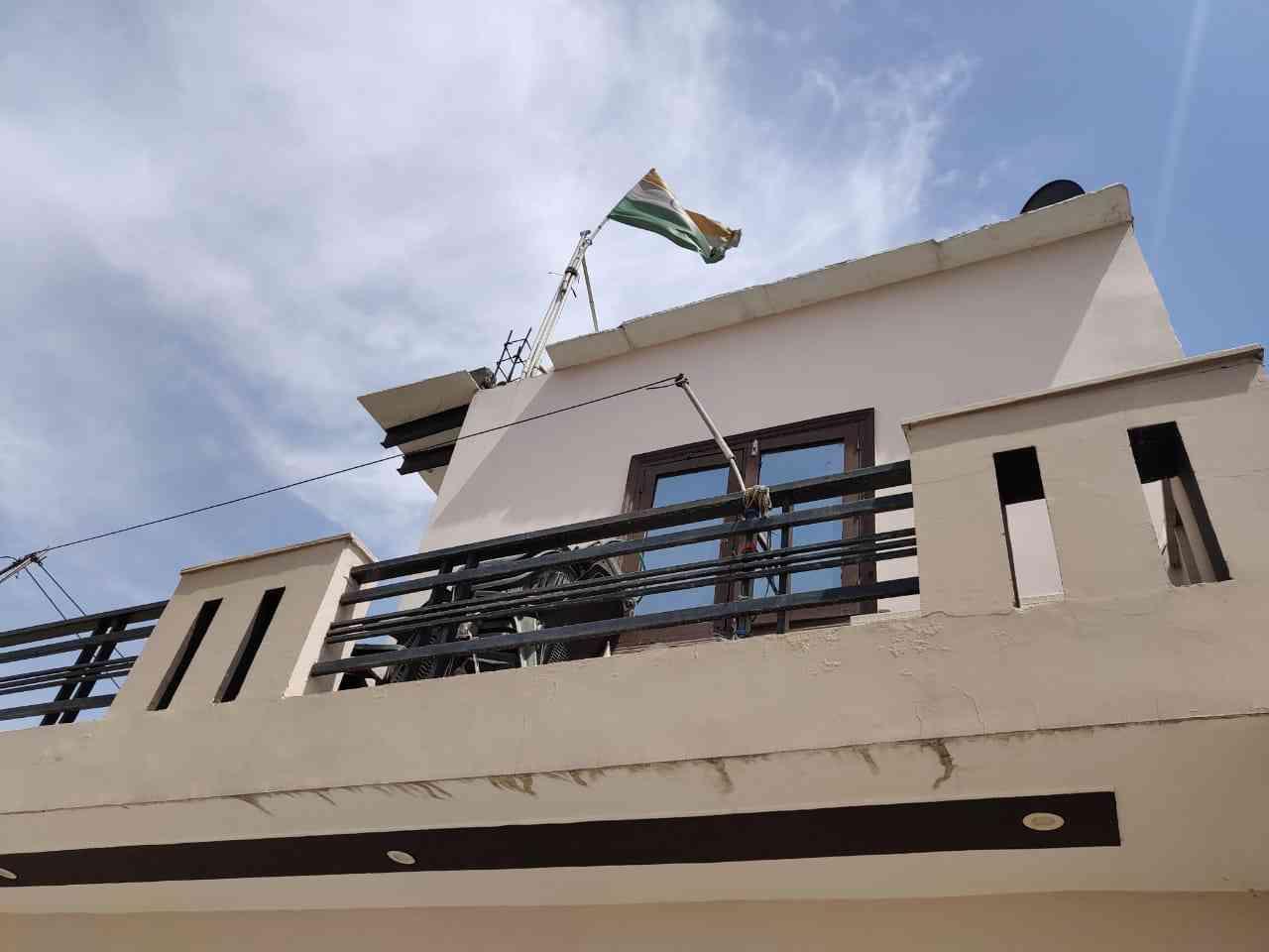 The Indian flag flies atop the family's home. Photo credit: Sandeep Yadav