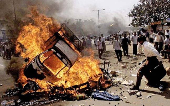 The image of the 2002 Gujarat riots passed of as a photo from Basirhat by a BJP spokesperson.