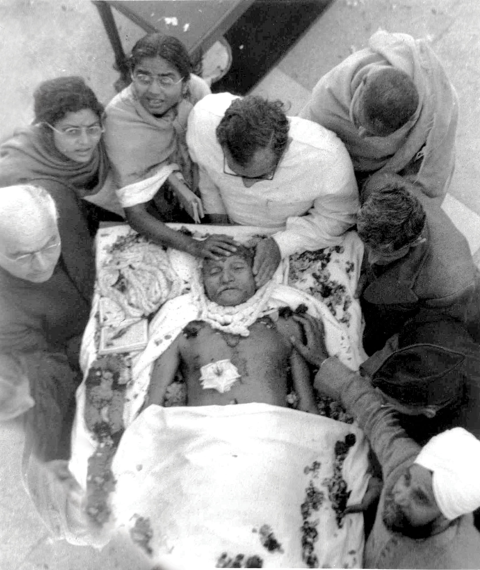 Gandhi after he was shot dead by Nathuram Godse in Delhi on January 31, 1948. Godse was unhappy with Gandhi's efforts to end the communal rioting and blamed the Mahatma for Muslim appeasement. Credit: Getty Images