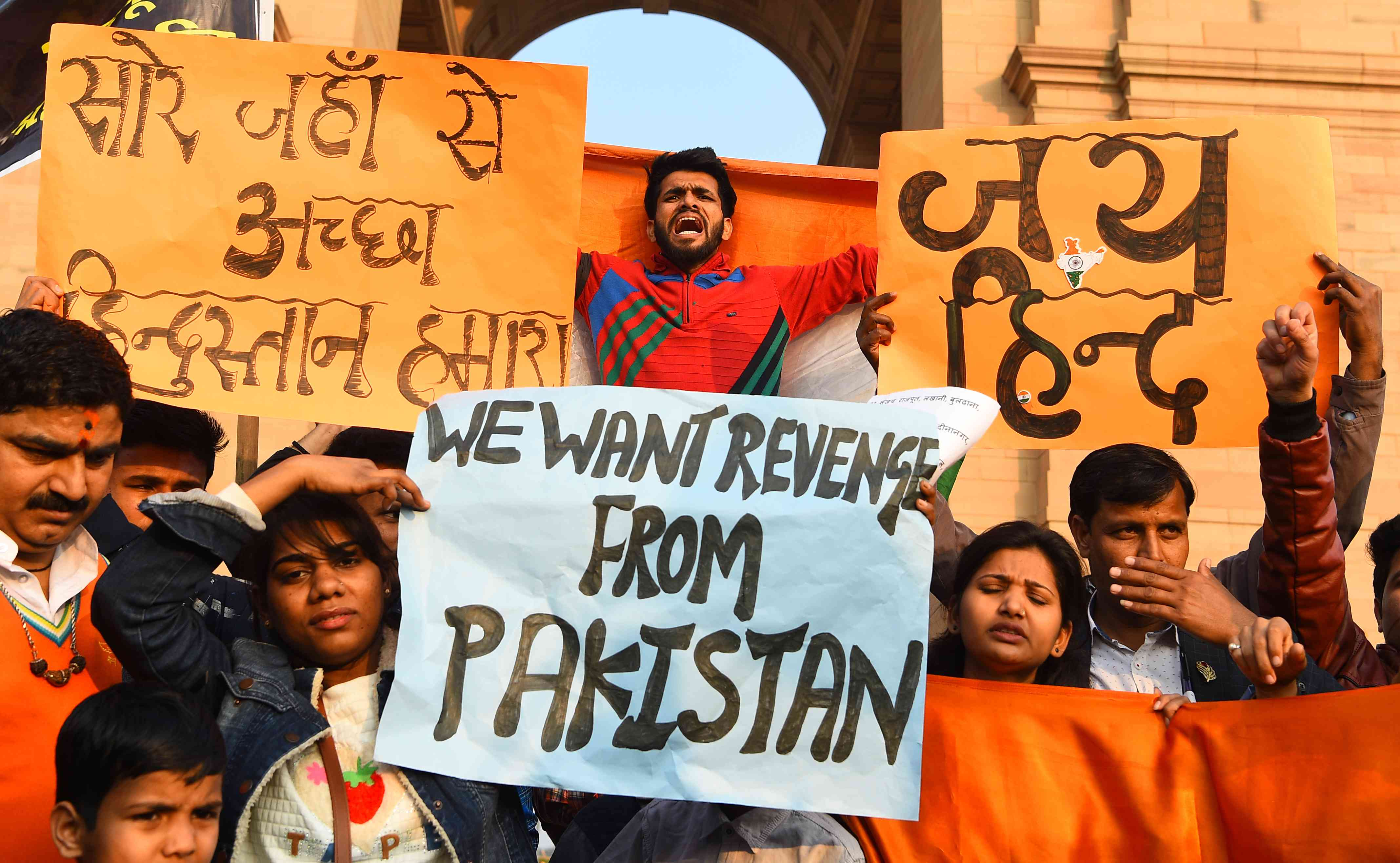 Protestors demand action against Pakistan at Delhi's India Gate on Saturday after a terror attack killed 40 Central Reserve Police Force personnel on February 14. Credit: Sajjad Hussain/ AFP