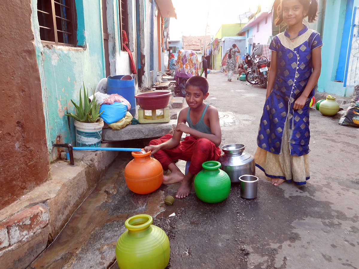 Children fetch water from a public tap in Ghousia Colony in Mysuru. The colony gets water once every four days.