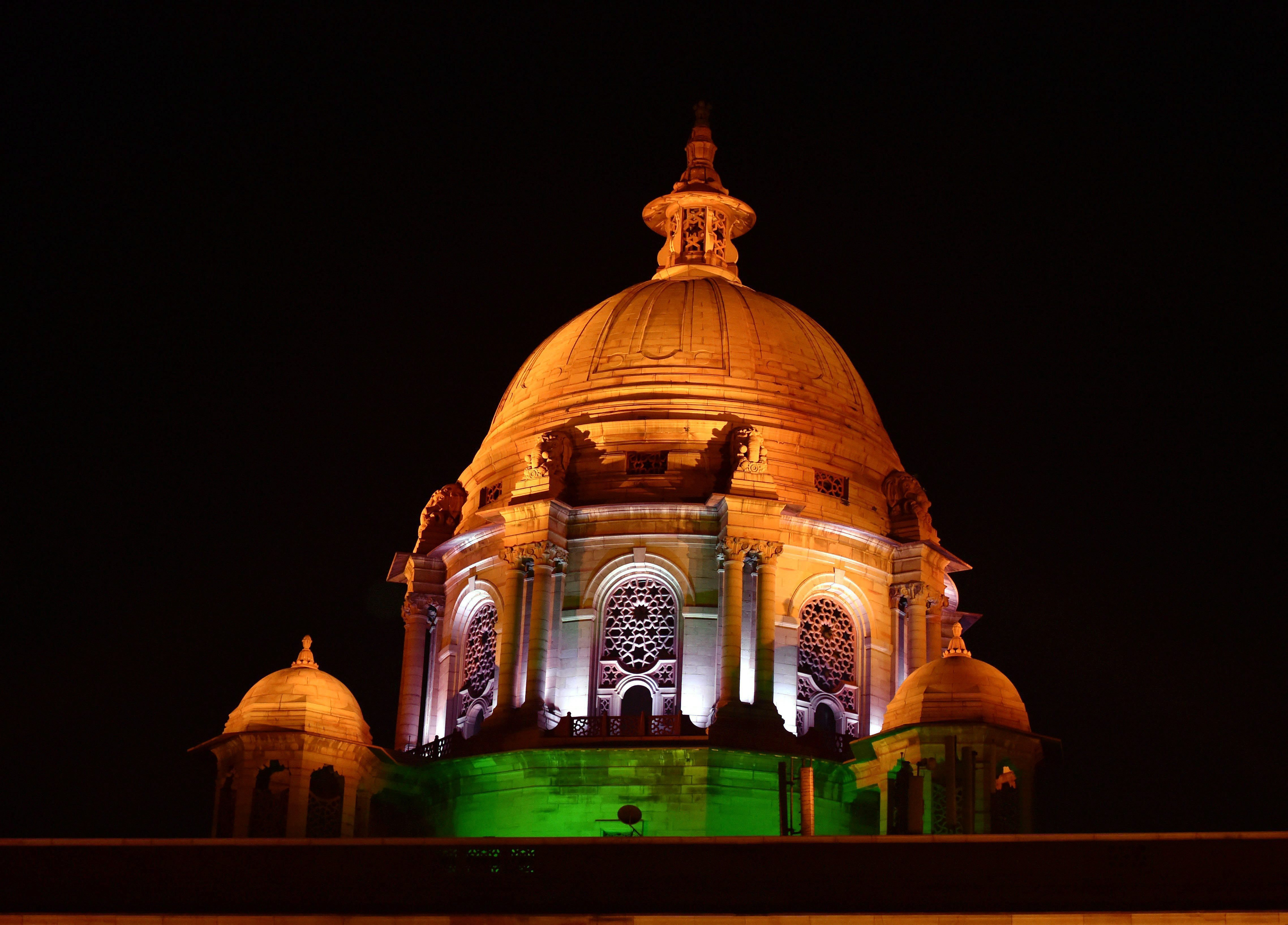 The dome lit up in the colours of the Indian tricolour. (Credit: PTI)