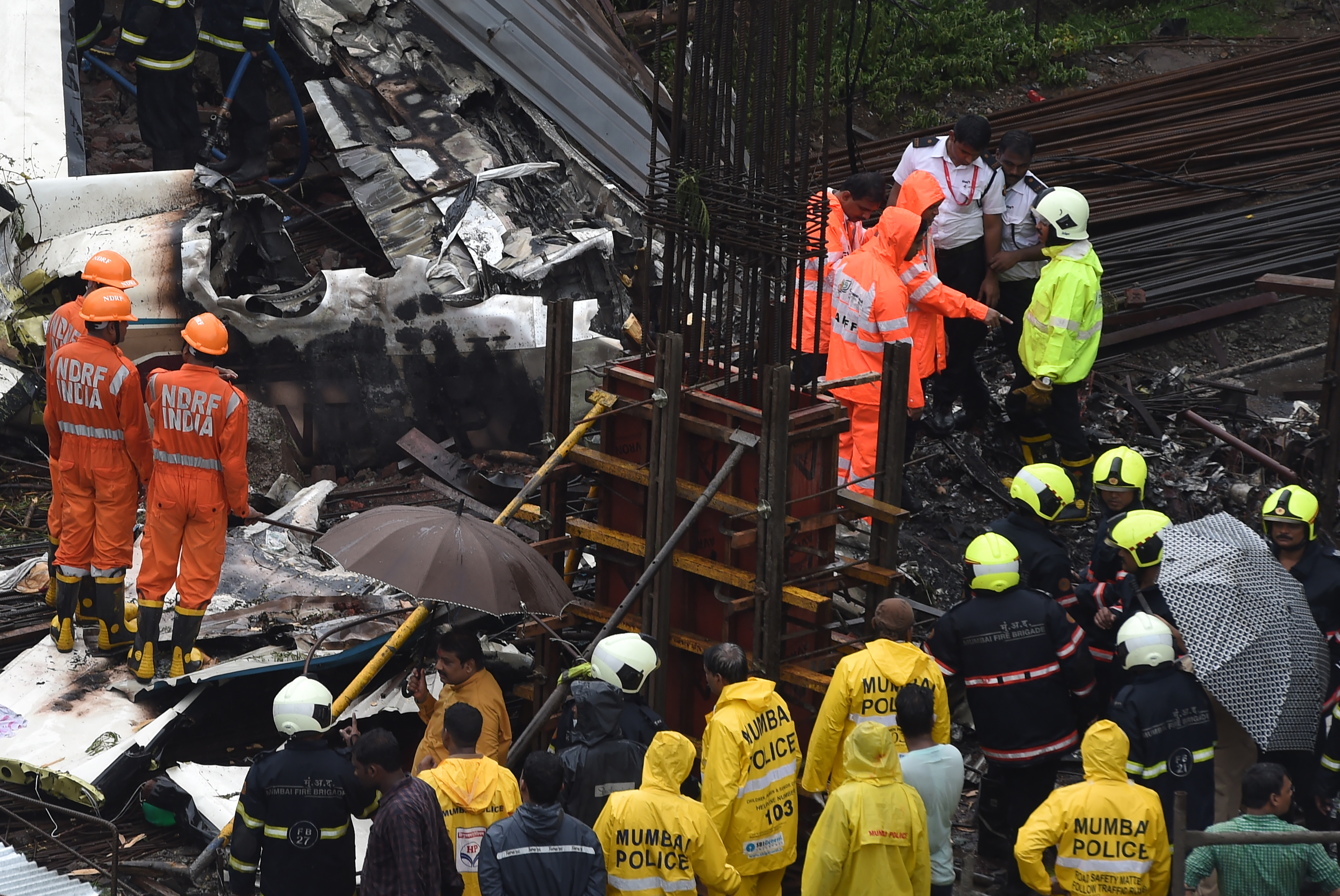 The Mumbai Police, NDRF and other rescue services personnel at the crash site. (Credit: AFP)