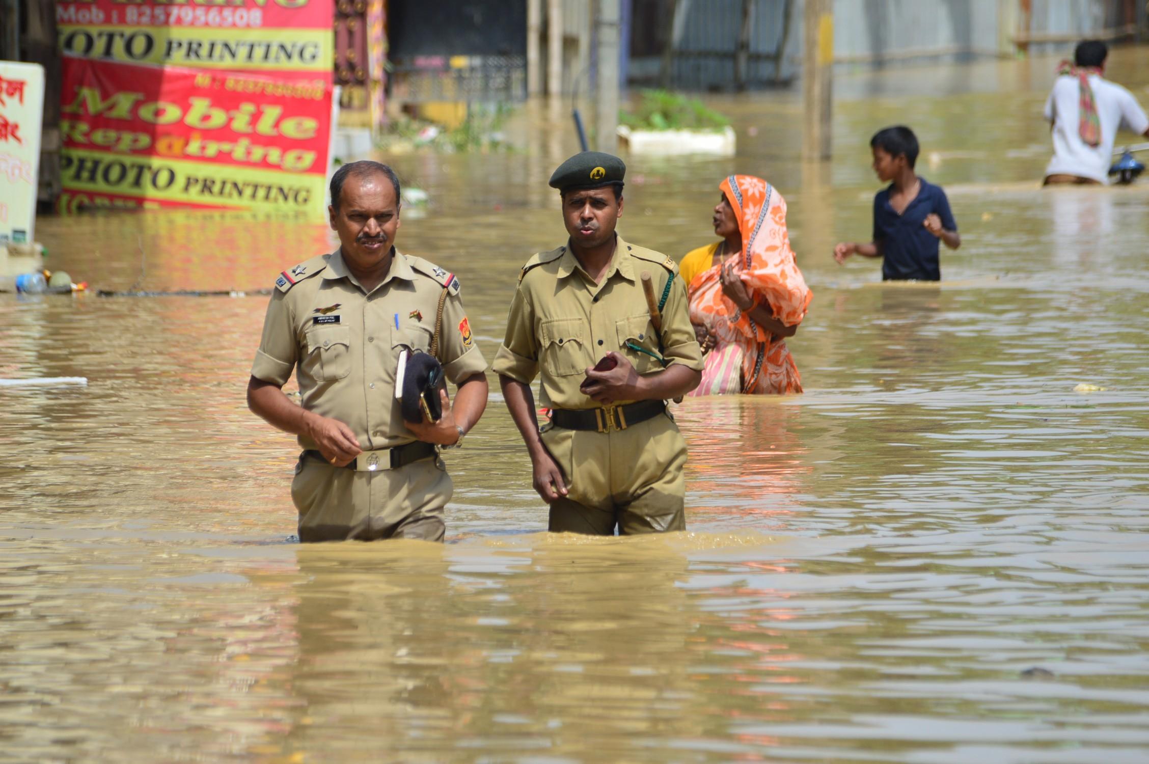 Rescue teams wade through the water. Photo credit: Abhishek Saha