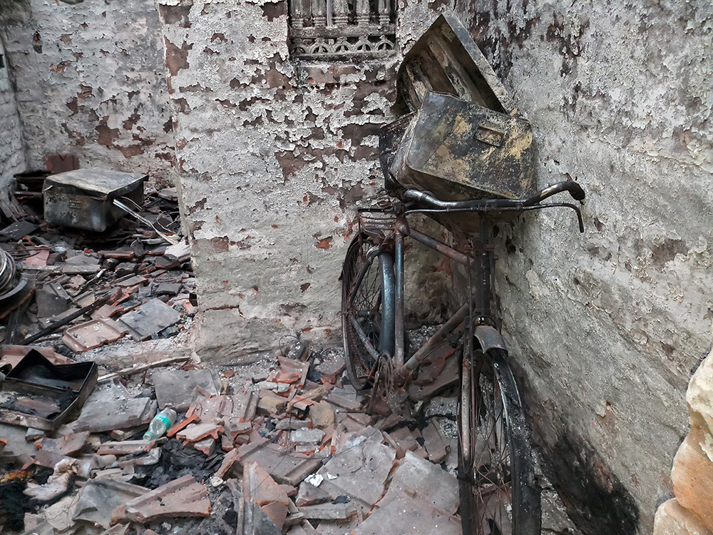 Husna Begum's house has been reduced to burnt rubble. Photo: Gurvinder Singh